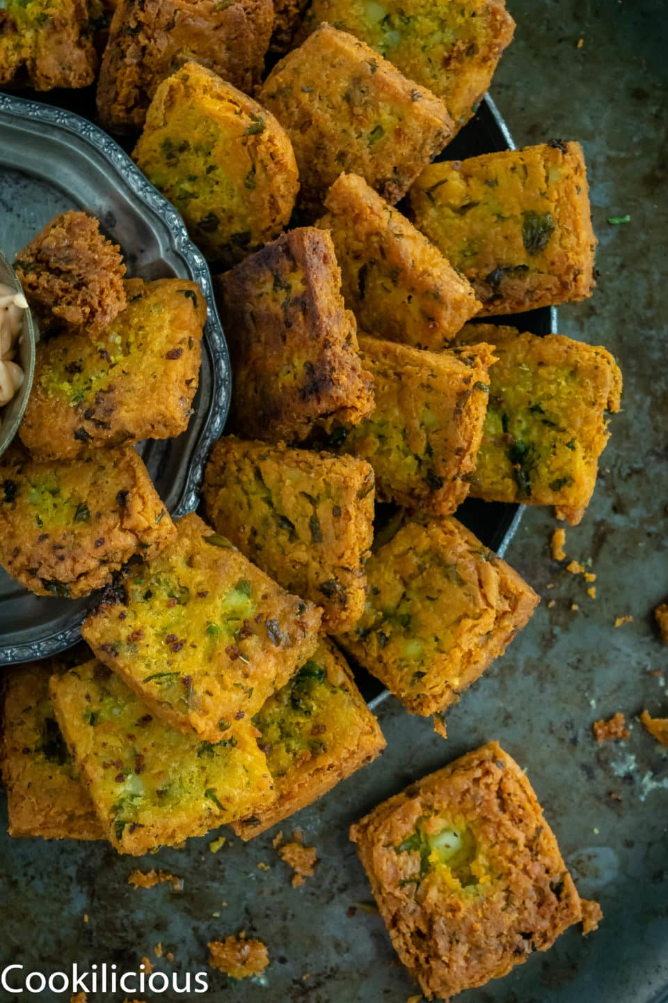 Fried Besan (Chickpea Flour) & Potato Squares placed in a platter