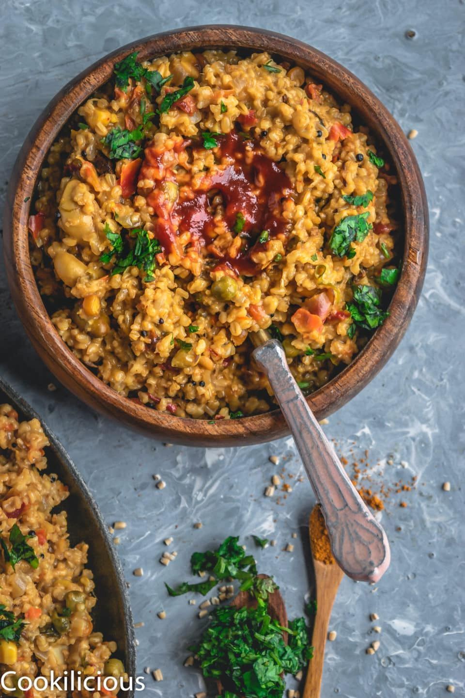a bowl of Instant Pot Oats & Vegetable Upma with ketchup in the middle