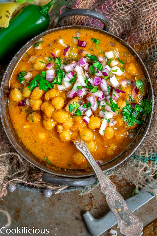 close up shot of South Indian Chickpeas Curry | Chettinad Kondai Kadalai Kuzhambu in a kadai