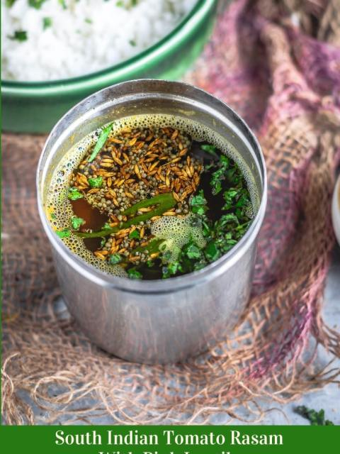 South Indian Tomato Rasam With Pink Lentils in a stainless steel vessel and text at the bottom