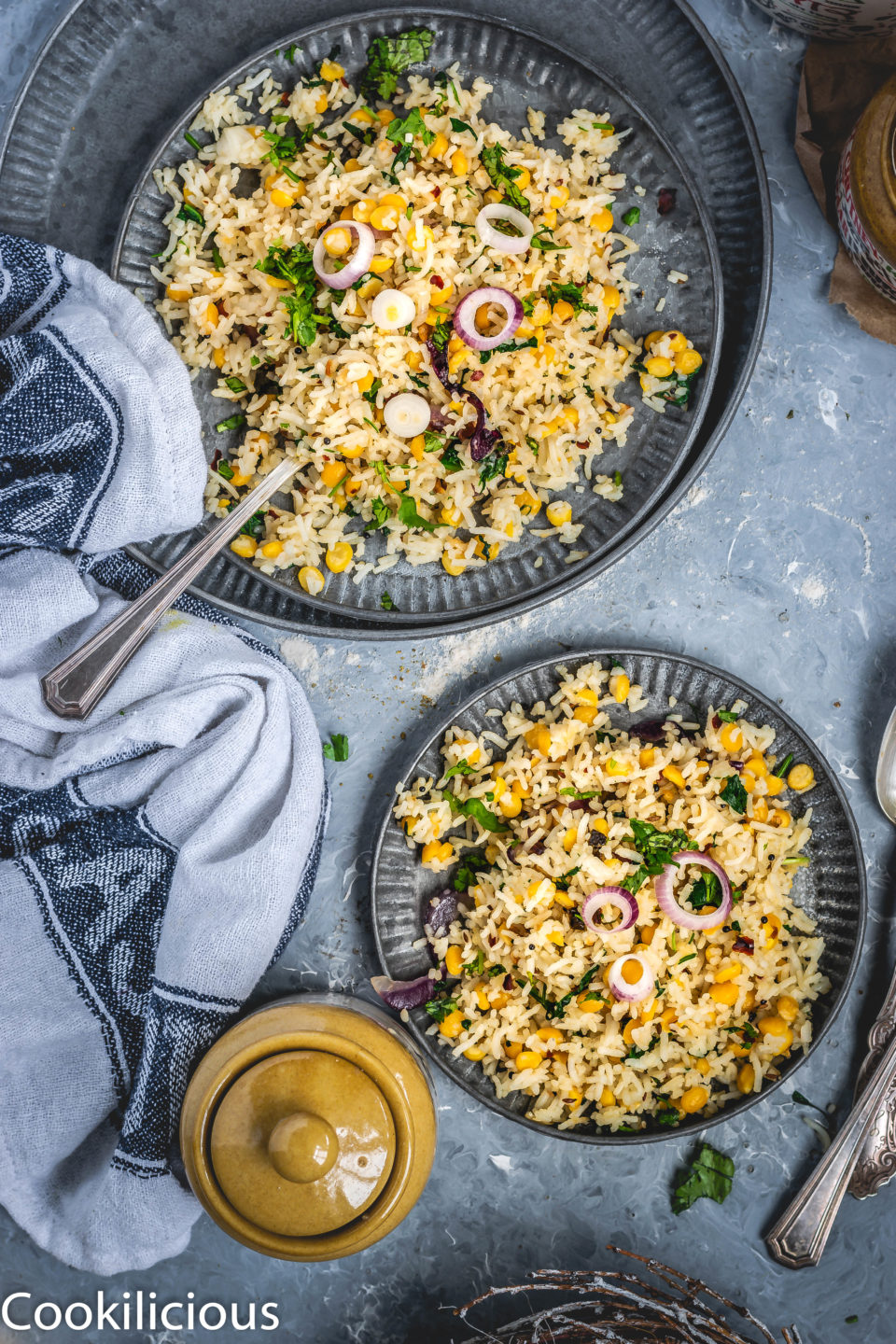 flat lay image of one big and one small plate with Cilantro, Spinach & Lentil Rice in it.