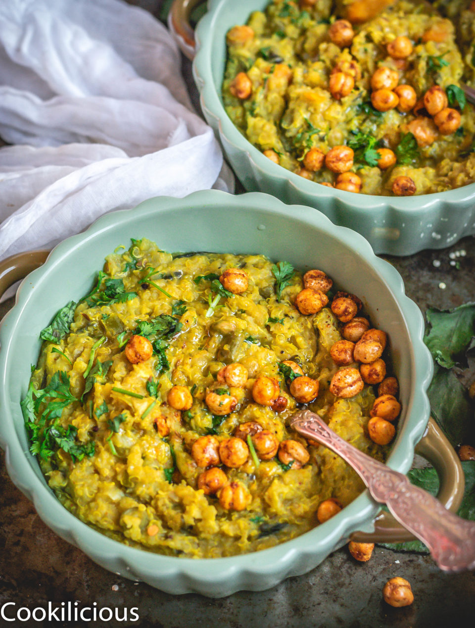 close up shot of Instant Pot Quinoa & Chickpeas Khichdi in a bowl with a spoon in it
