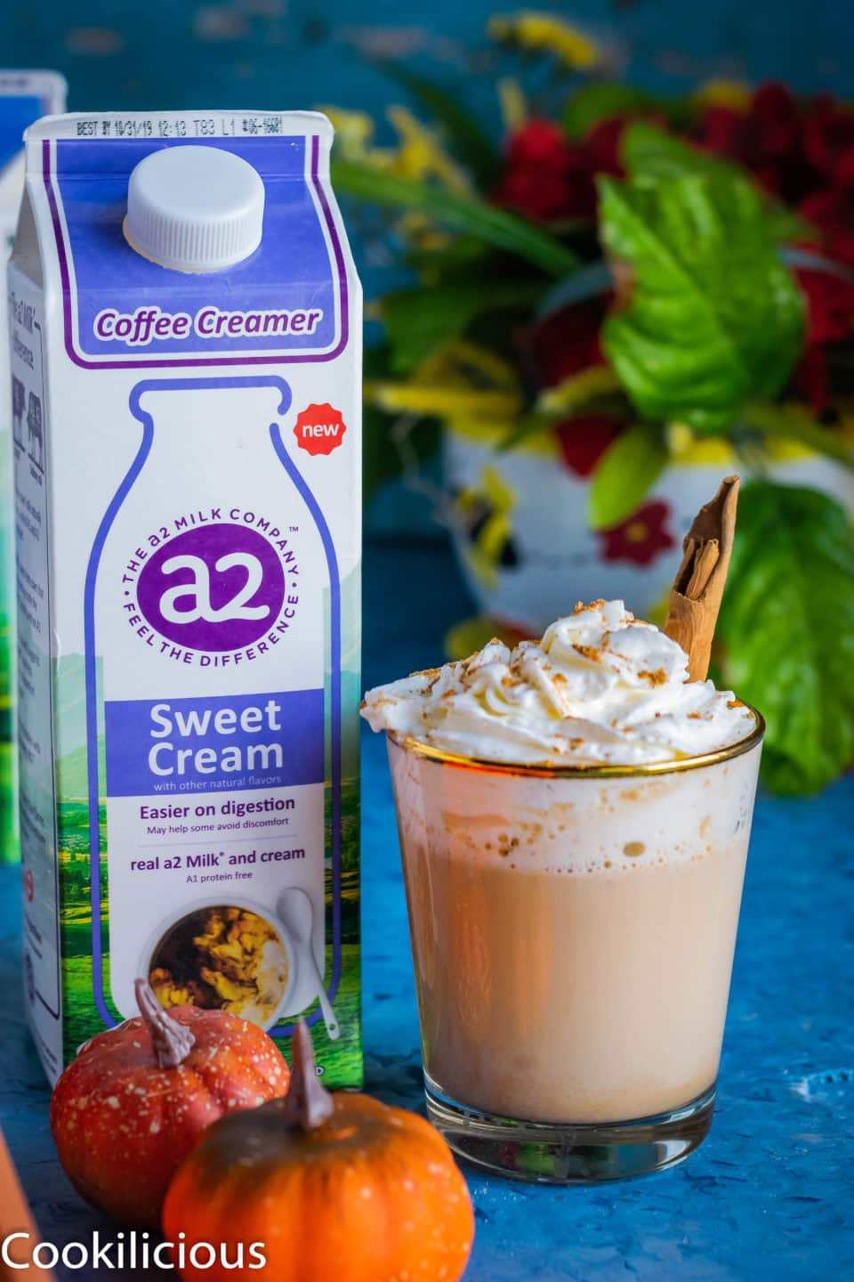 a glass of Spiced Coffee & Pumpkin Latte with an a2 milk carton next to it
