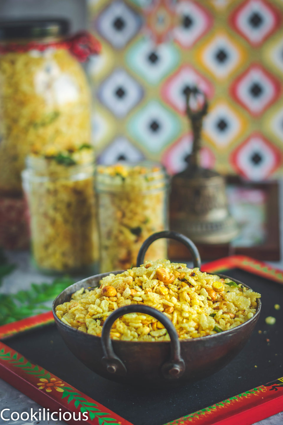 Rice Krispie Chivda in a kadai with 2 glass jars filled with the same in the background