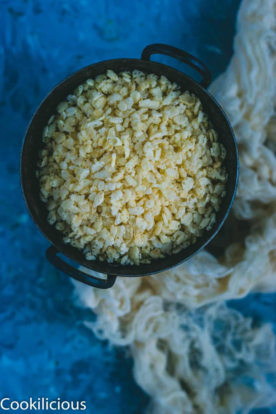 rice krispies in a kadai used to make Rice Krispie Chivda