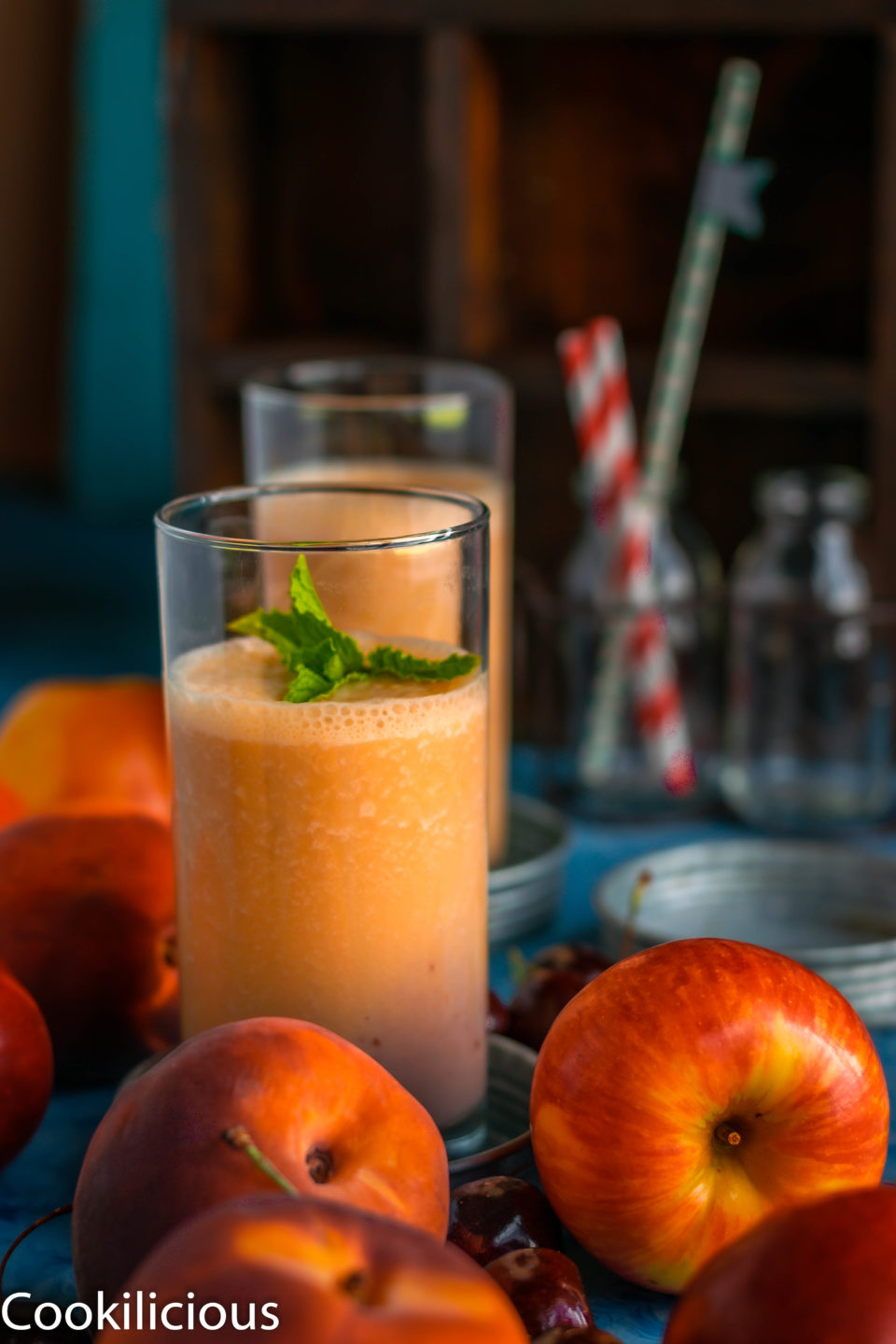 Peach & Raspberry Creamsicle Vegan Smoothie with apples and peaches in the front