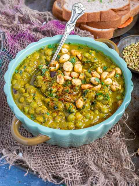 Pumpkin & Pigeon Peas Vegan Curry in a bowl with a spoon in it