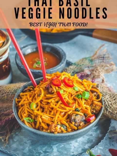 Asian Style Thai Basil Tofu Stir Fry Noodles with chopsticks in it and text at the top