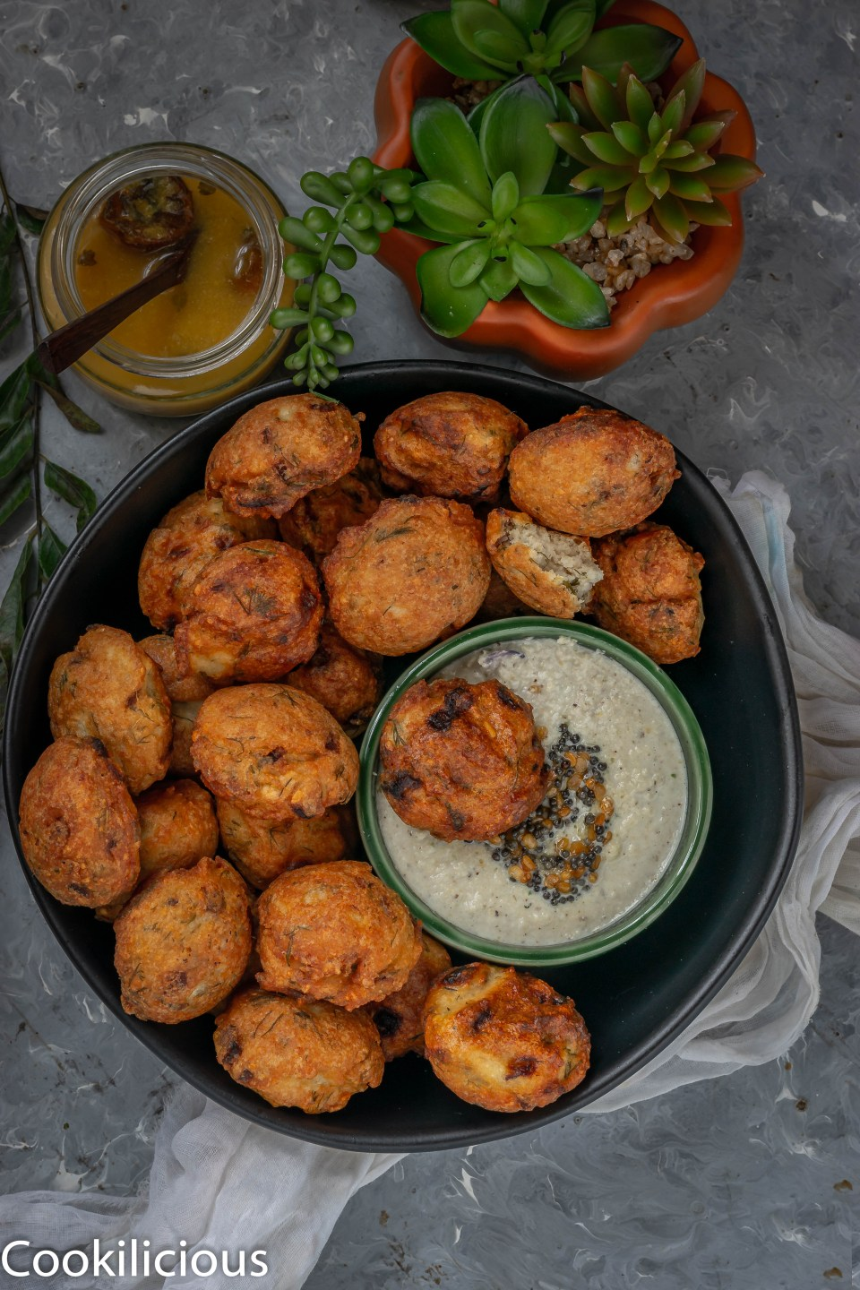 a platter of Dill Flavored Lentil Fritters along with coconut chutney