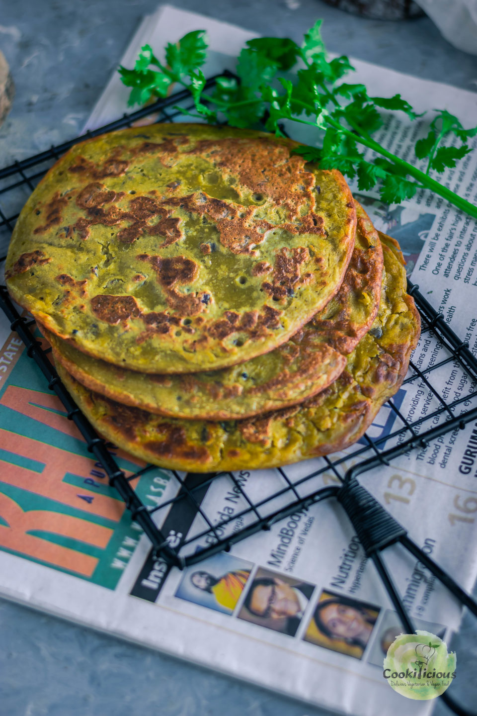close up shot of Lentil Pancakes with Leftover Dal placed one on top of the other