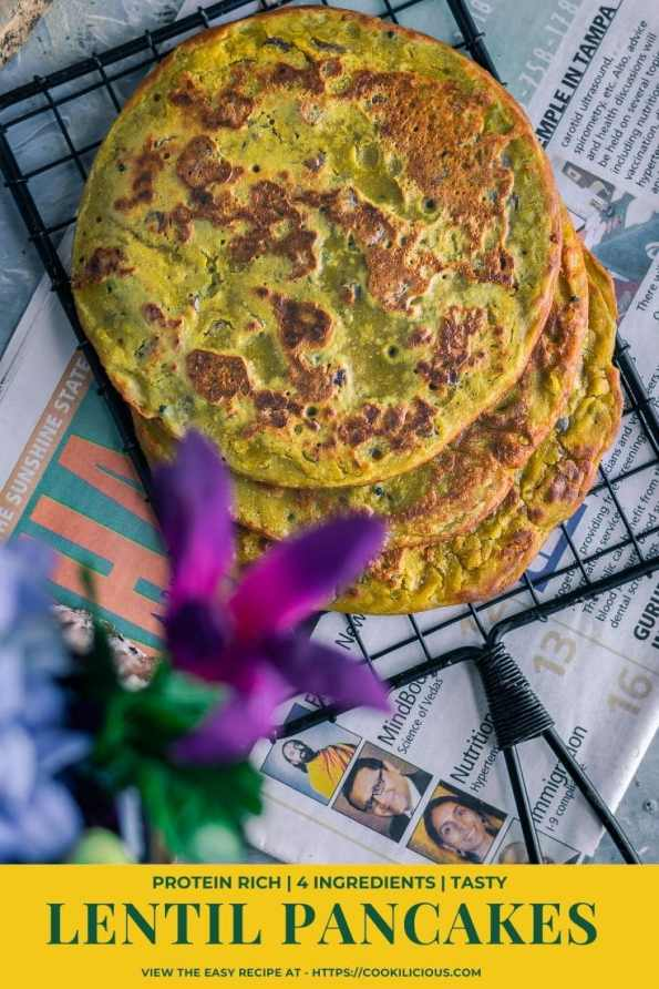 top view of Lentil Pancakes with Leftover Dal over a wire rack & text at the bottom