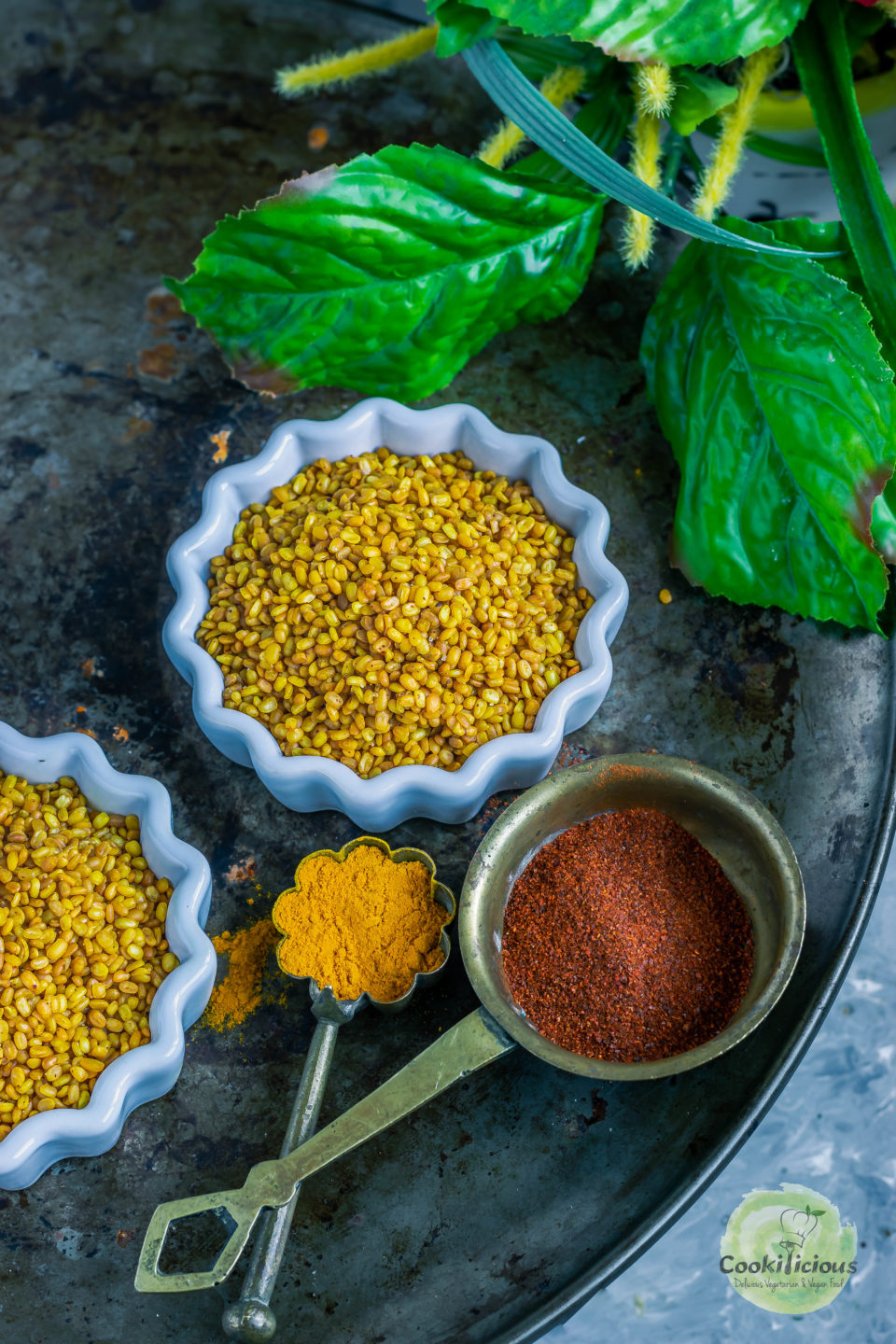 one bowl of Crunchy Moong Dal with chilly powder and turmeric powder next to it
