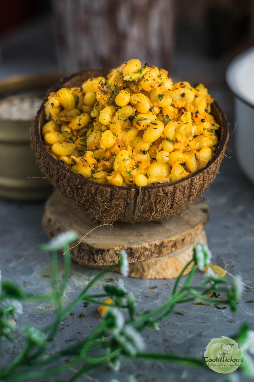 navy beans sundal salad in an empty coconut shell