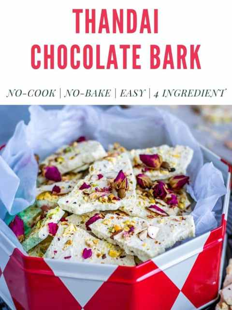 a box filled with thandai chocolate bark with text on top