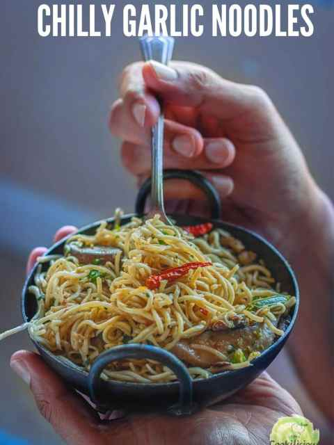 a set of hands enjoying a bowl of Chilly Garlic Noodles with text at the top