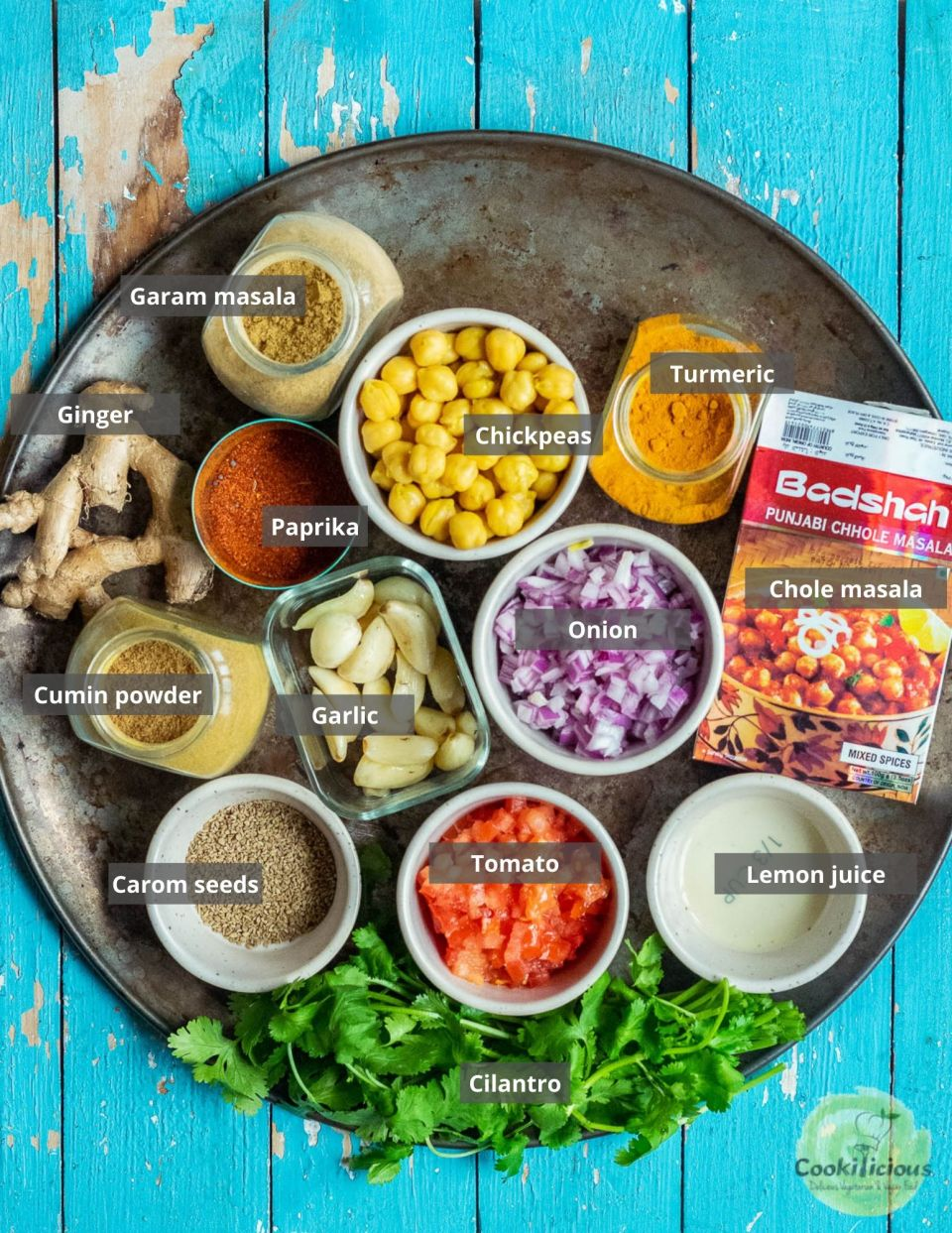 all the ingredients needed to make Tawa Chole   Chickpea Stir Fry arranged on a tray