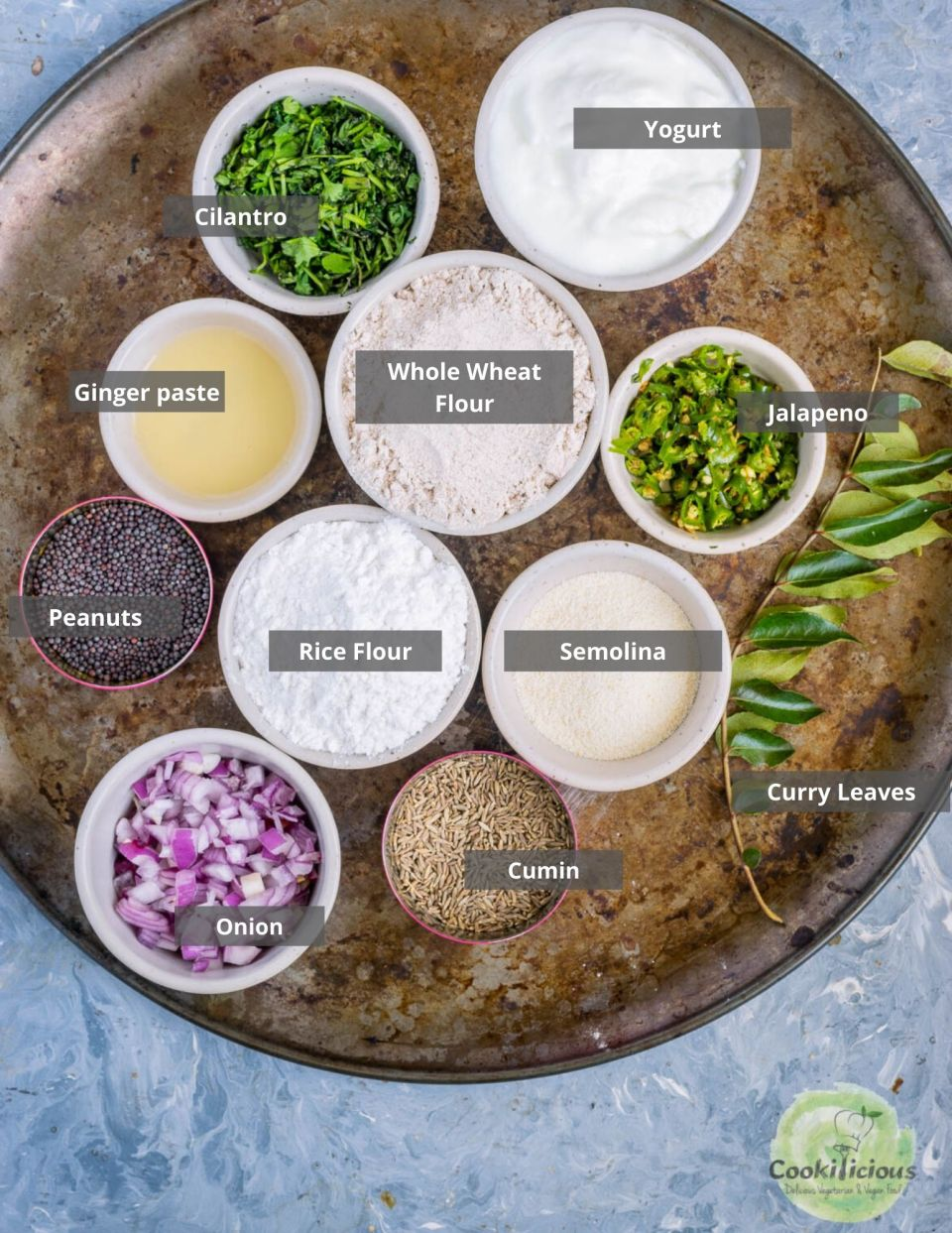 all the ingredients needed to make Wheat Dosa | Instant Wheat Rava Dosa placed in a tray with labels on them
