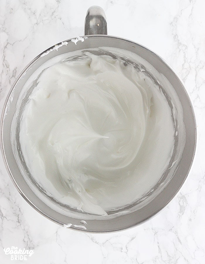 meringue in a metal mixing bowl