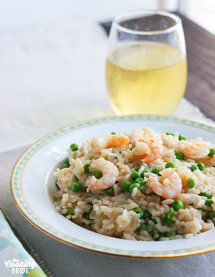 Creamy shrimp risotto is simmered in seafood stock, then served with succulent shrimp, sweet green peas, and Parmesan cheese.