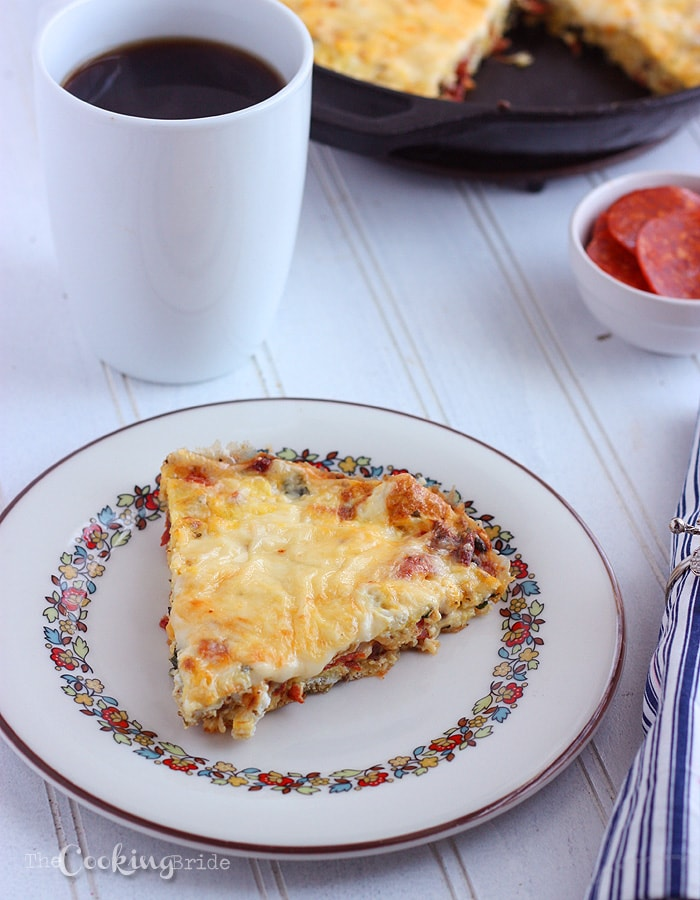 Pepperoni and fresh herbs are combined with eggs and cheese to make a delicious easy frittata recipe perfect for breakfast, lunch, or dinner.