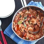 Try this tasty recipe for hearty slow cooker jambalaya. Chicken, spicy andouille sausage, and shrimp simmered in a slow cooker and served over rice.