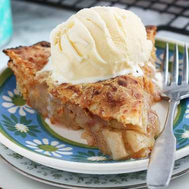 granny smith apple pie with ice cream on a plate