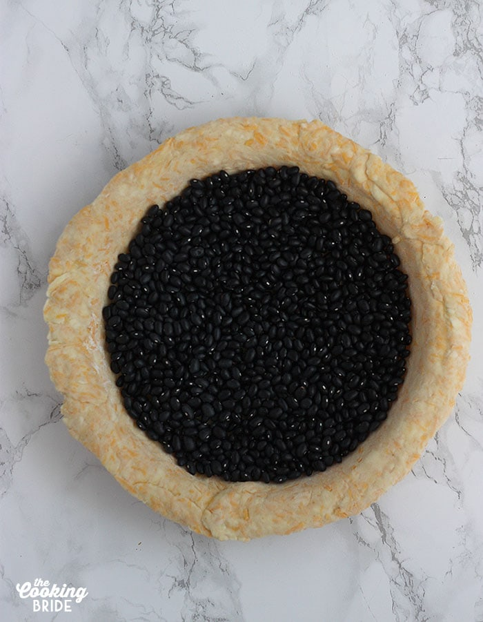 pie crust weighted with dried beans