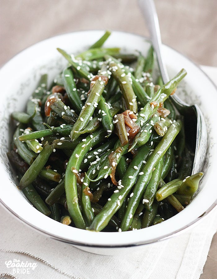 Sauteed green beans are stir fried in an Asian-inspired sauce of ginger, garlic and sesame oil for an easy, flavorful, and healthy side dish.