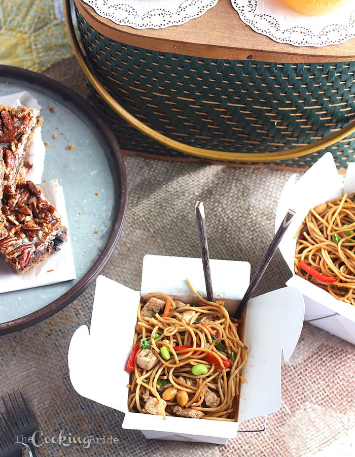 Asian noodle salad in white Chinese take out boxes with chop sticks