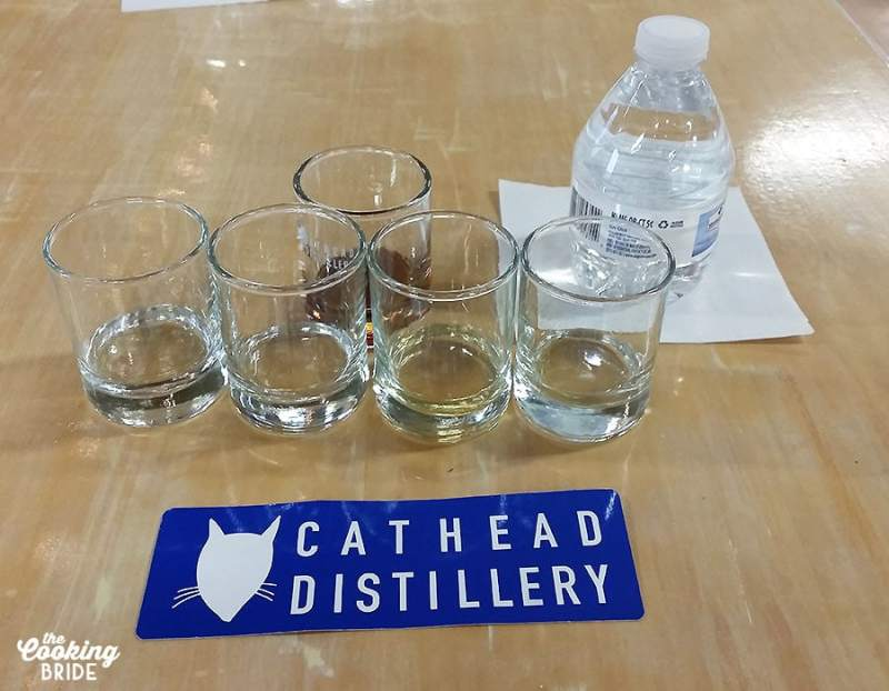 cathead distillery shot glasses lined up on a table