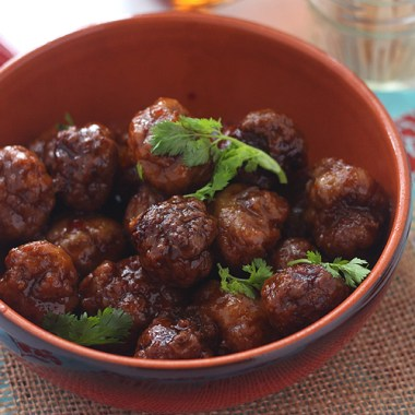 This chicken meatballs recipe is the perfect appetizer! It's glazed in a sweet and sour mixture of bourbon, apricot preserves, mustard, and chili garlic sauce.