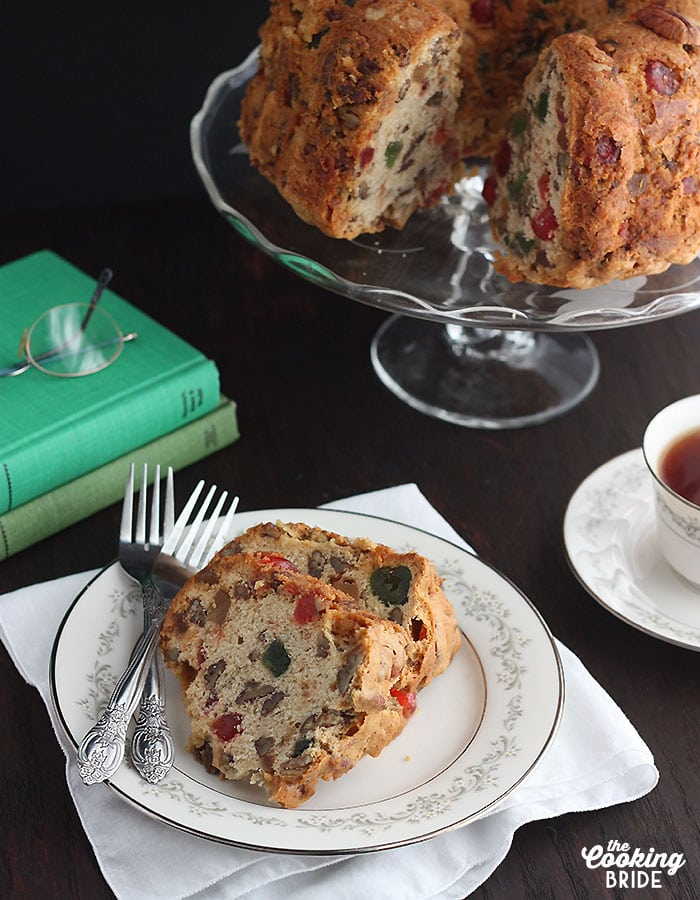 """Moist, white fruitcake is a little lighter than traditional dark fruitcake. This Southern version """"improved"""" by dribbling it with bourbon instead of rum."""