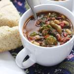 Pot likker, the flavorful liquid leftover after cooking down a pot of greens, is the base of this hearty soup. It's also chock full of tender beans and veggies.