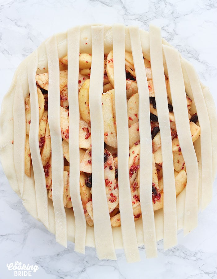 lattice pie strips arranged over an unbaked pie
