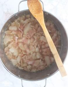 boiled hog jowl in a stainless steel pot
