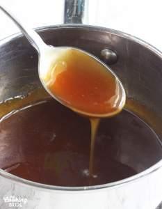 metal spoon dipped in bourbon glaze