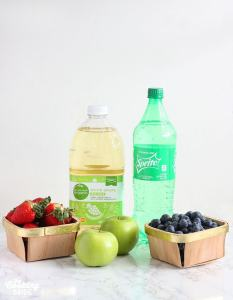 berry punch ingredients including fresh strawberries, green apples, blueberries, white grape juice and sprite