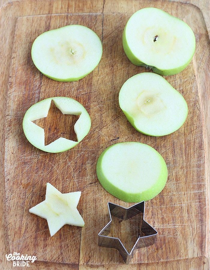 cutting star shapes out of apple rounds