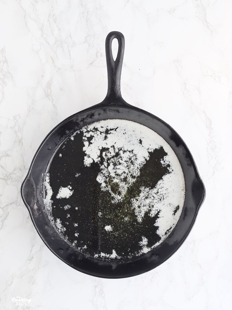 melted butter in a cast iron skillet