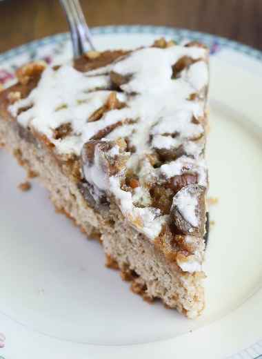 slice of fig cake being served on a blue and white floral plate