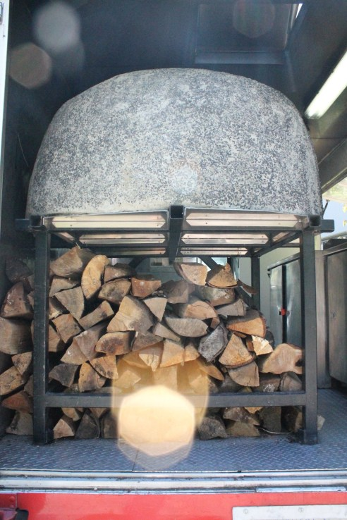 The Community Pizzaria Food Truck comes with a built-in, wood-fired, pizza oven.