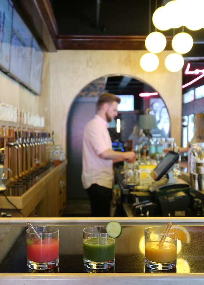 a bartender preparing a drink behind a bar