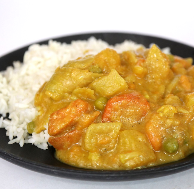 Plate of vegetable curry with rice