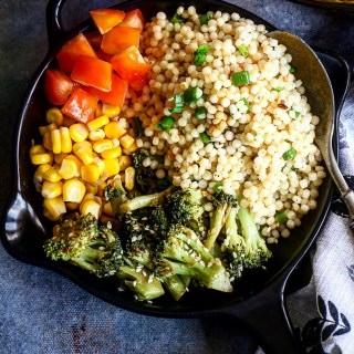 Garlic & Sesame Pearl Couscous with Broccoli, Corn & Tomatoes