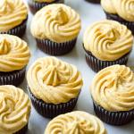 A Large Batch of Cupcakes Decorated with Frosting