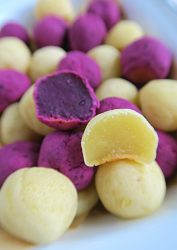 Bowl full of purple and white sweet potato mochi balls