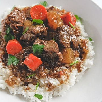Chinese beef stew over rice.