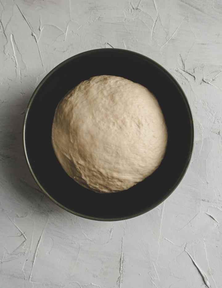shaobing dough in a dark blue bowl