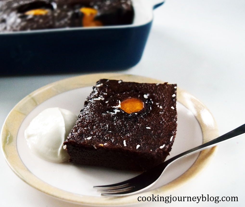 chocolate pudding cake, slice on a plate, served with Skyr