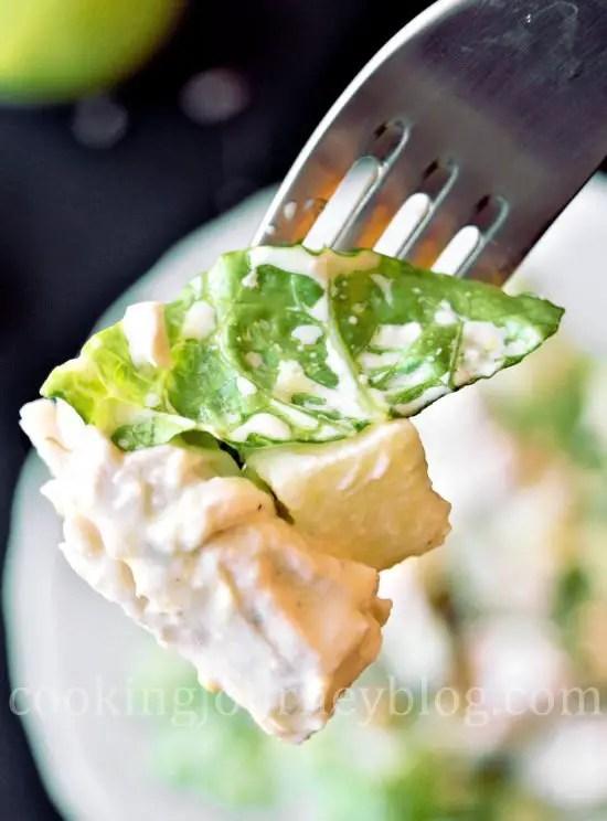 Avocado chicken salad on a fork